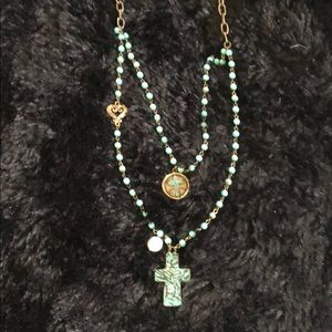 Jewelry - Lightweight turquoise colored bead with crosses.